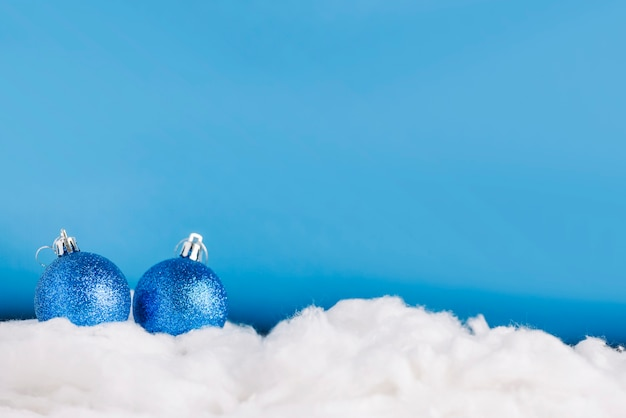 Christmas balls on decorative snow