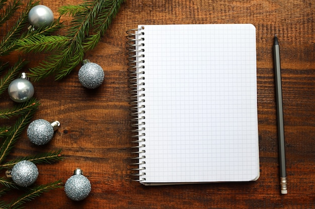 Christmas balls and empty notebook for writing goals