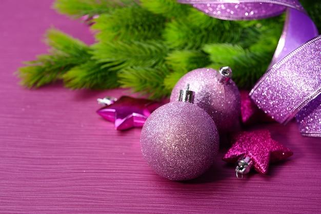 Christmas balls on fir tree, on color background