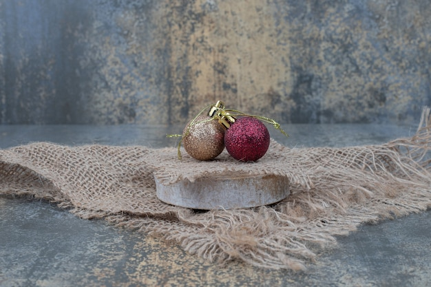 Christmas balls on marble table with burlap. high quality photo