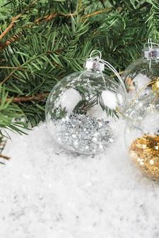Christmas balls near fir twig