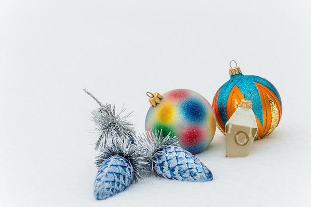 Christmas balls on snow, holidays background