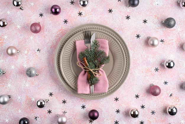 Christmas balls and stars with dinner setting