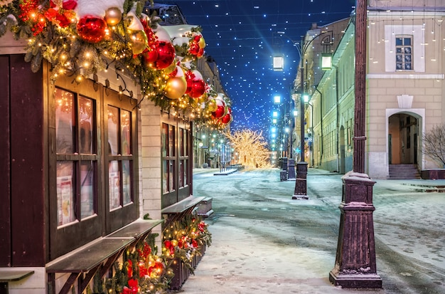 Christmas balls and trees in kamergersky lane in moscow early winter morning