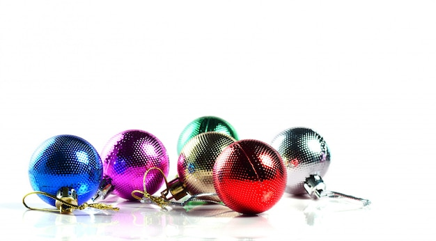 Christmas balls with ornaments on white background.