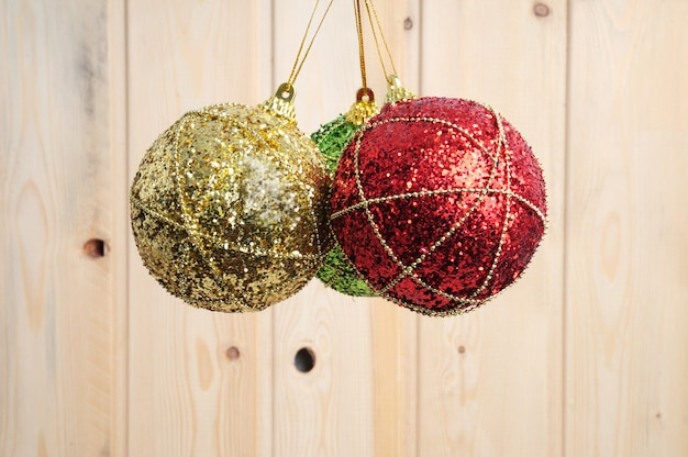 Christmas balls on wooden table