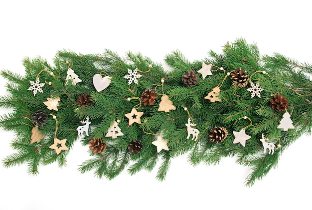 Christmas banner border with fir branches and wooden christmas tree toys isolated on white. vintage banner frame in rustic style. copy space