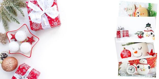 クリスマスバナー、クリスマスボール、枝、ギフトの箱、白いテーブルの上のクリスマスカード。コピースペース。