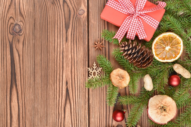 Christmas banner made of fir branches, toys and eco-decorations.