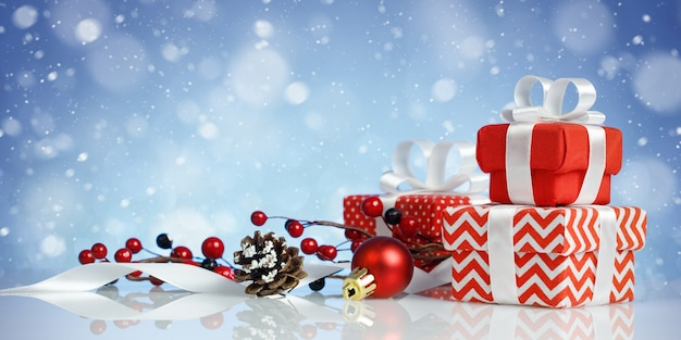 Christmas banner with three red gift boxes and decorations on blue background