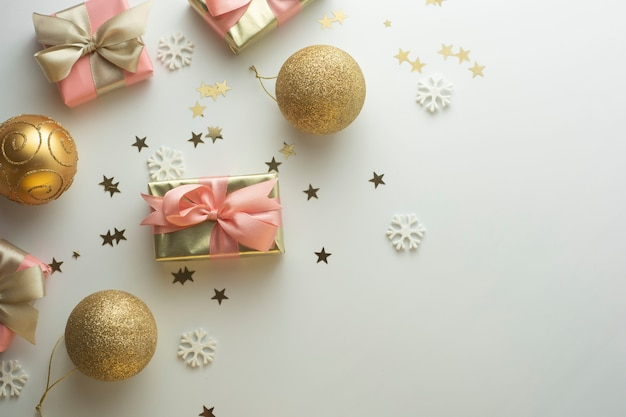 Christmas, baubles golden gift boxes party, birthday . celebrate shinny surprise copyspace. creative flat lay top view.