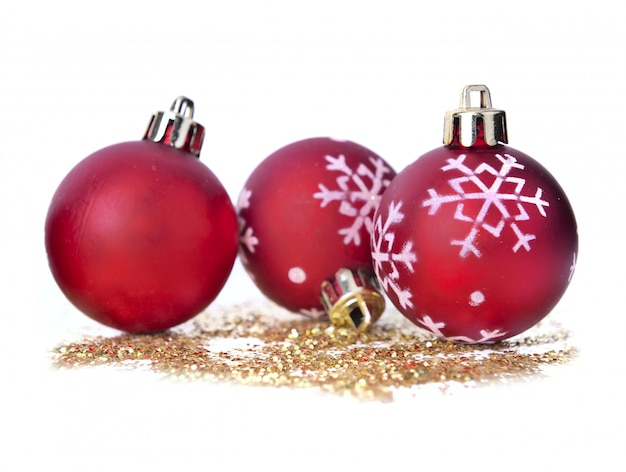 Christmas baubles on golden glitters