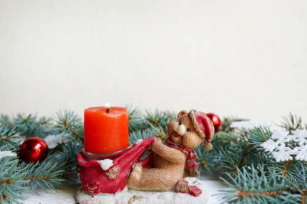 Christmas bear candle with tree pine and new year decoration, copy space