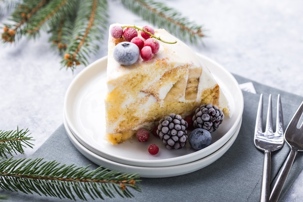 Christmas biscuit cake with cranberries and new year  decorations on a  .