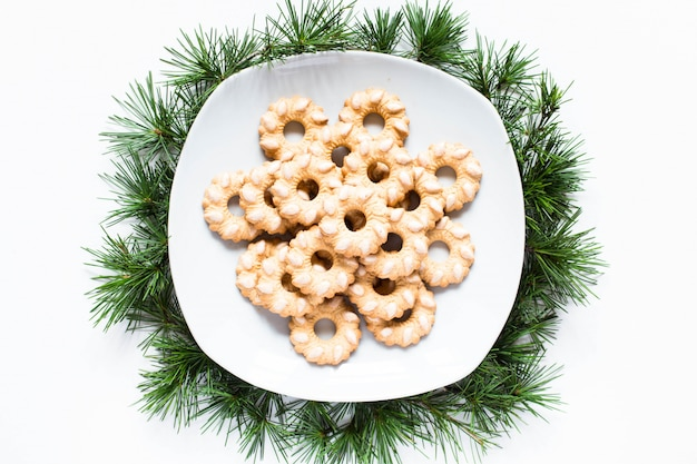 Christmas biscuits on a dish on white surface