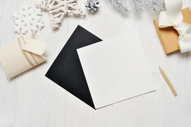 Christmas black greeting card letter in envelope and gift