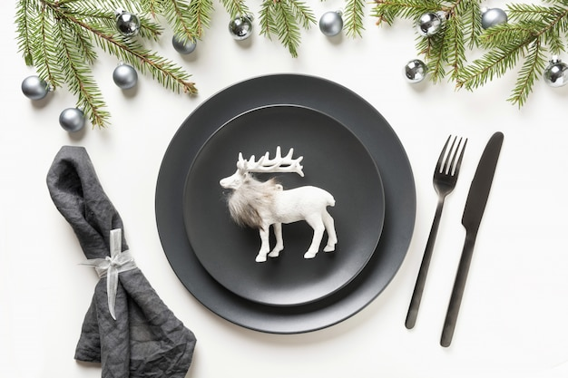 Christmas black table setting with reindeer on white background