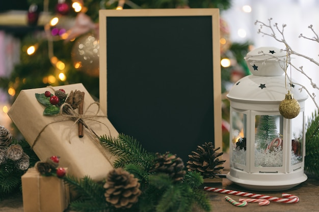 Christmas bokeh background decorated with chalkboard ,gift box, white lantern, pine cone,candy cane.