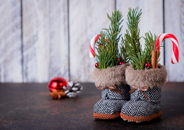 Christmas boots background. new year toy for christmas tree. holiday card. copy space
