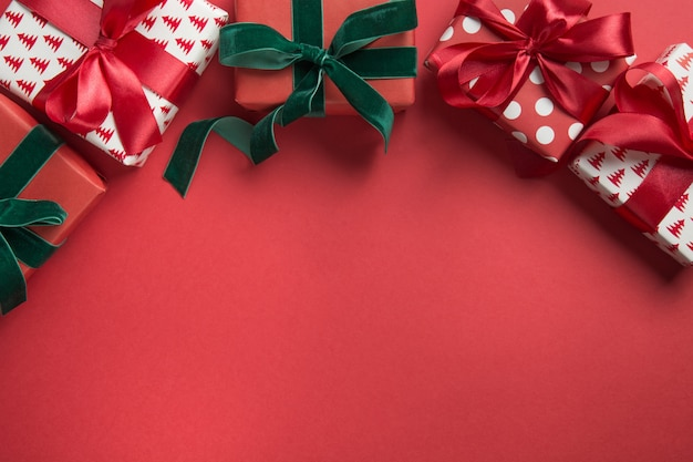 Christmas border of holiday gifts on red background. boxing day. greeting card.