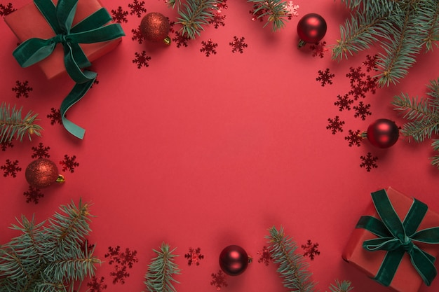 Christmas border with fir tree and gifts on red background. merry christmas card. winter holiday.