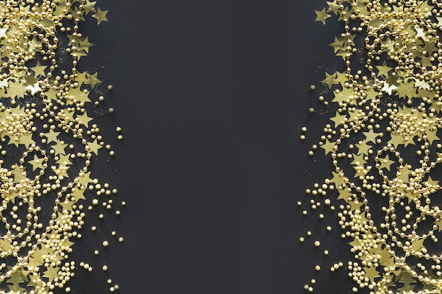 Christmas border with golden decoration on black flat lay view from above xmas banner.