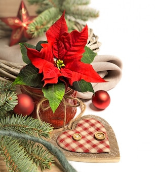 Christmas border with poinsettia and winter decorations, text space