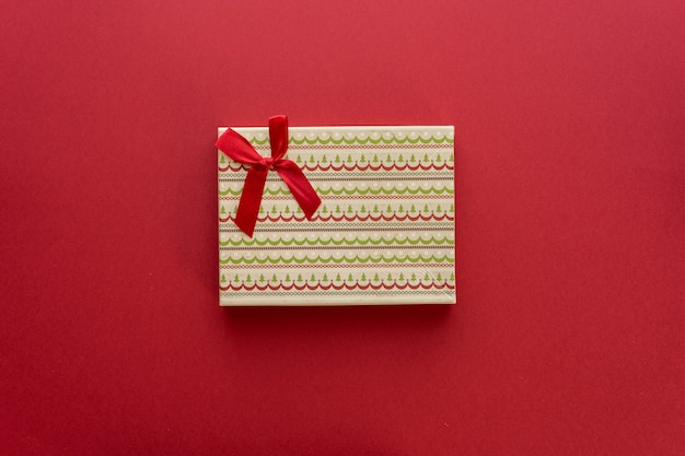 Christmas box with a gift on a red background. flat lay, top view, space for text