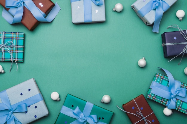 Christmas boxes with globes on green background