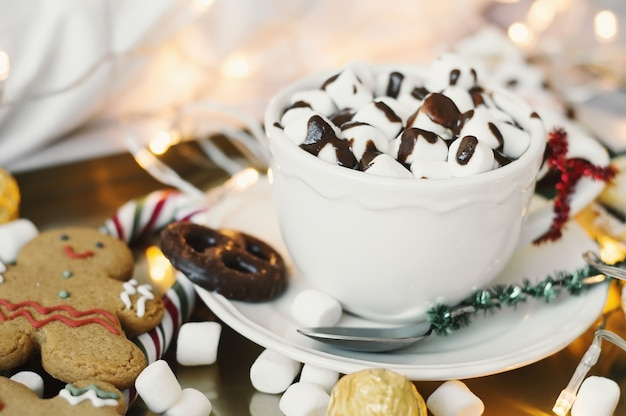 Christmas breakfast: hot chocolate with marshmallow, cookies, sweets and gingerbread man