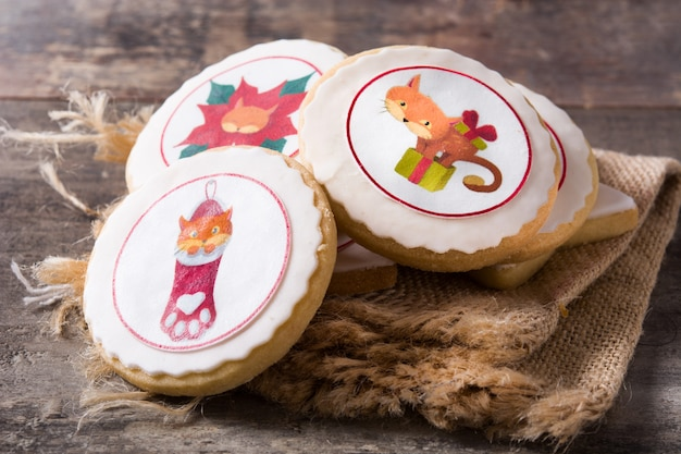 Christmas butter cookies decorated with christmas draws on wooden table
