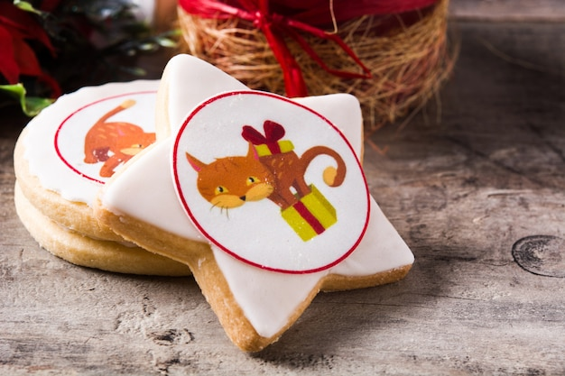 Christmas butter cookies decorated with christmas graphics, on wooden table