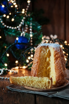 Christmas cake panettone on the wooden table