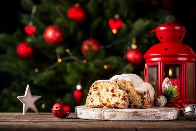 Christmas cake stollen with dried fruits with red candle