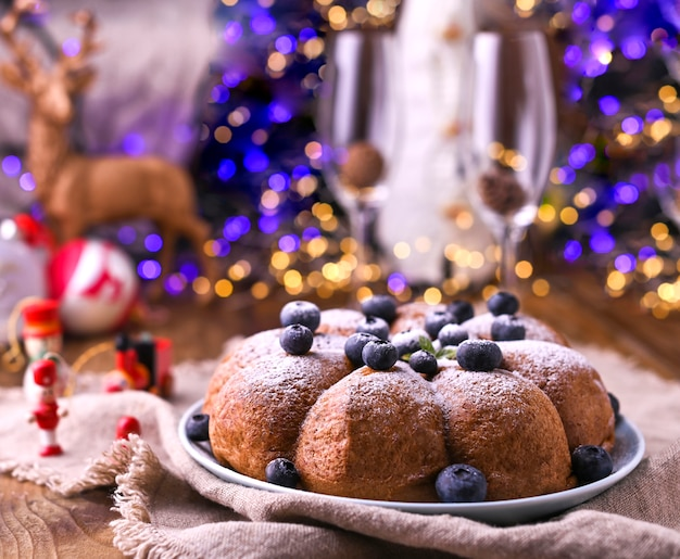 Christmas cake with berries and icing sugar