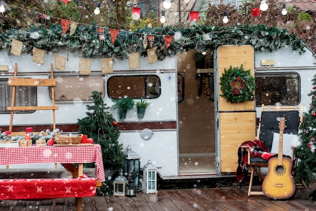 Christmas camping. the trailer is decorated with christmas decor.
