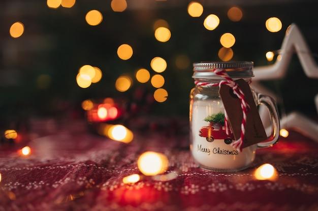 Christmas candle, christmas lights bokeh, candle light.