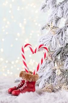 Сердце тростника леденца рождества, предпосылка боке.