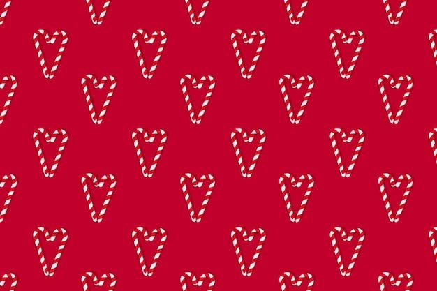 빨간색 배경 패턴에 모양의 크리스마스 사탕 지팡이 심장