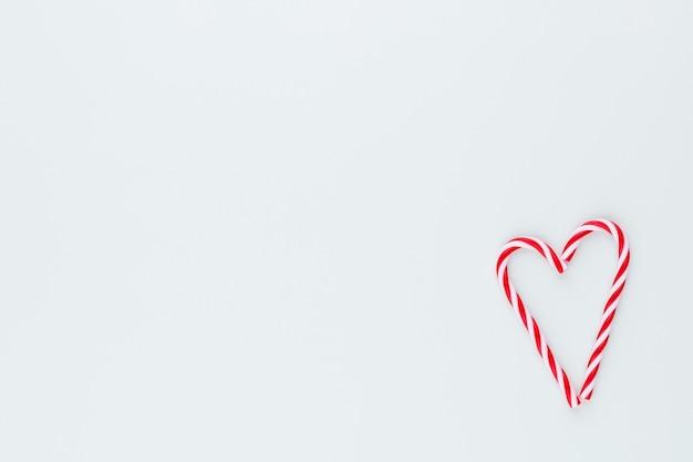 크리스마스 사탕 지팡이 심장의 모양에 거짓말