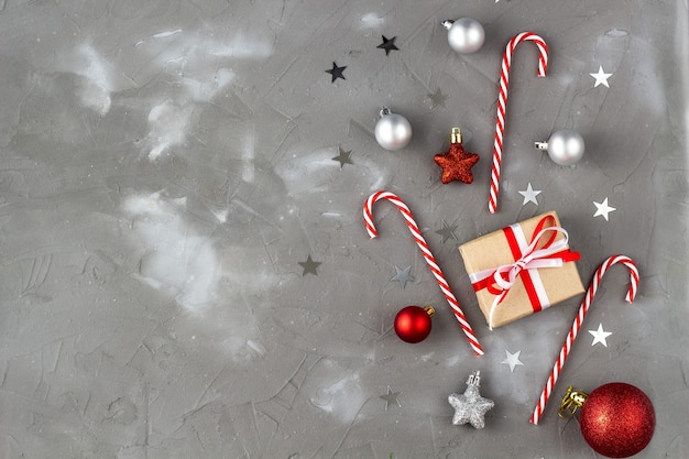 Christmas candy cane red and silver balls stars. new year celebration concept with gift