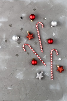 Christmas candy cane red and silver balls stars. new year celebration concept