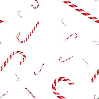 白で隔離のクリスマスキャンディケインシームレスパターン