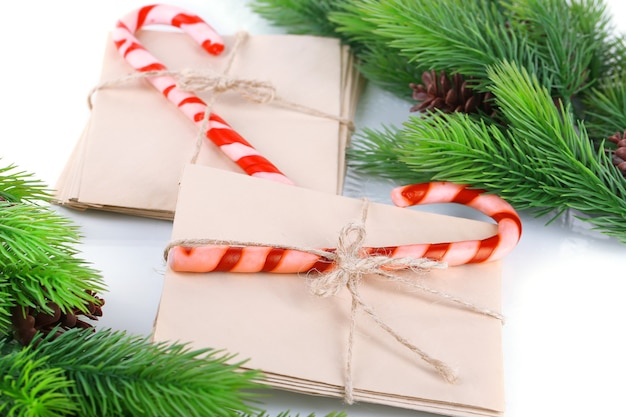 Christmas candy canes and letters for santa, isolated on white surface
