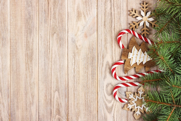 Christmas candy canes and snowflakes on wood