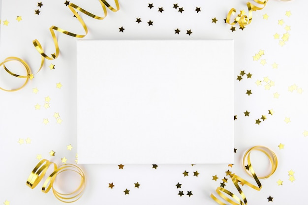 Christmas canvas mockup with golden festive decoration ribbon, stars on a white.