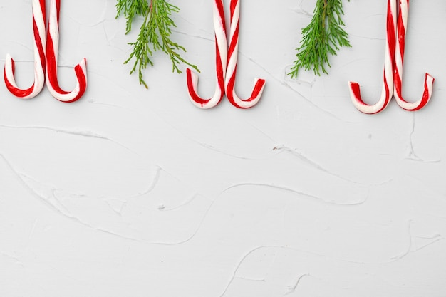 Christmas card background with candy cane copy space