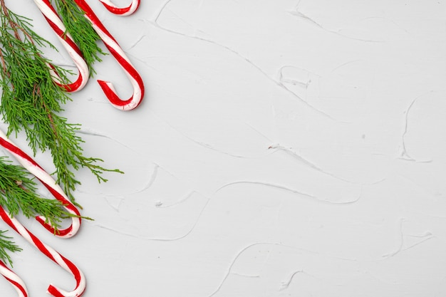 Christmas card background with candy cane, copy space