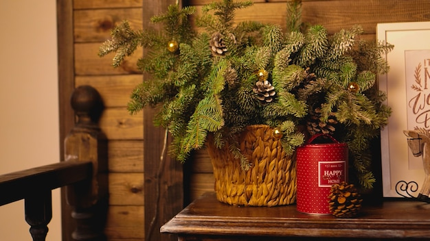 Christmas card - basket with green christmas tree branches
