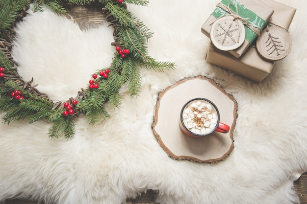 Christmas card. cup of coffee, wreath, handmade gifts